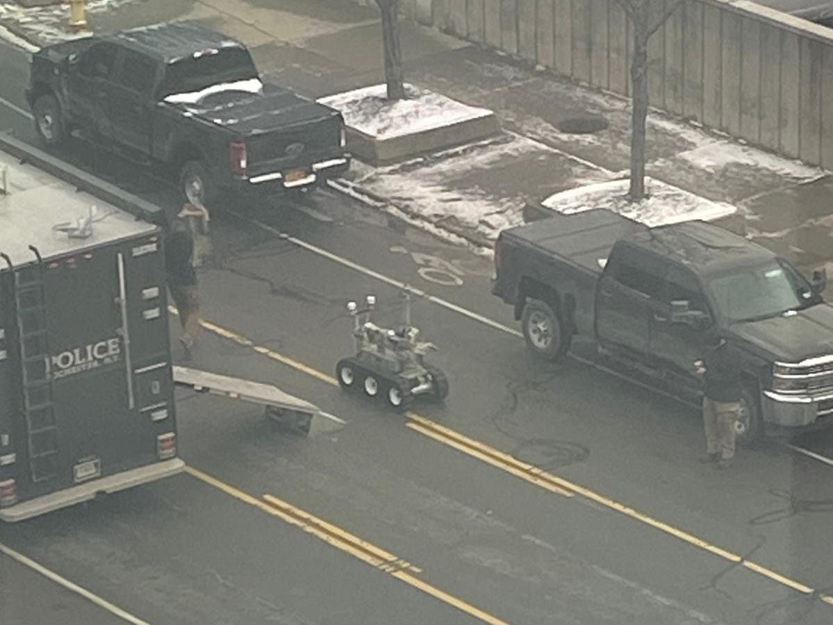 A robot with cameras is unloaded by the Rochester police bomb squad Thursday near the federal building.