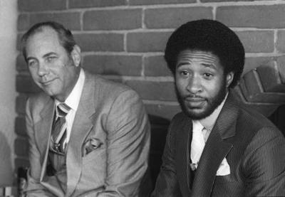 Ozzie Smith and his agent at news conference on possible trade