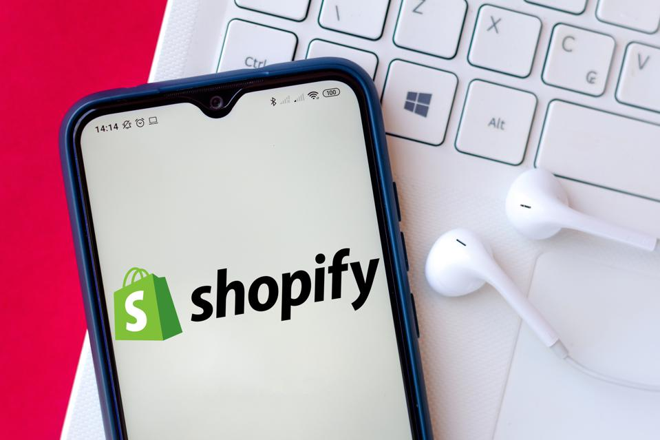 In this photo illustration the Shopify logo seen displayed...